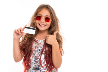 Little pretty caucasian girl with plastic card and she likes it, picture isolated on white background