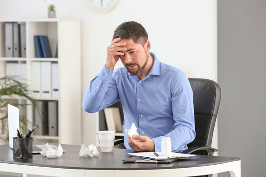 Man ill with flu working in office