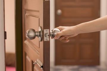 Women hand opens door Close up hand open door.