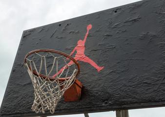 Jumpman logo by Nike on the basketball backboard