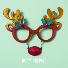 reindeer eyeglasses and text happy holidays