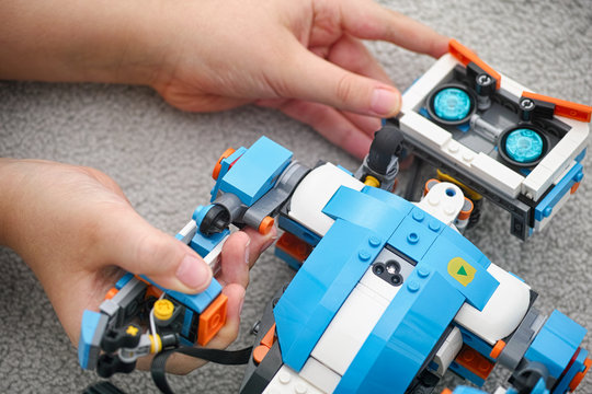 Tambov, Russian Federation - November 20, 2019 Lego Boost Vernie the Robot in hands. Close up.
