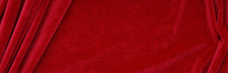 Long banner velvet texture red color background, expensive luxury fabric,  wallpaper. Christmas backdrop, copy space