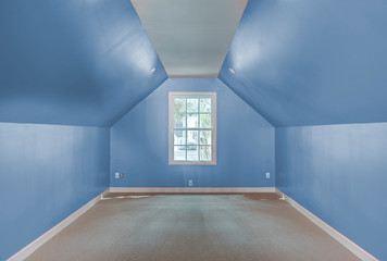 Empty attic bedroom or spare room.
