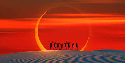 Wall Mural - Silhouette of friends jumping on the sand dune against Solar Eclipse