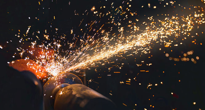 Hot sparks at grinding steel material - Sparks of welding