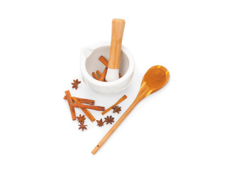 Preparation cinnamon powder in ceramic mortar isolated on white background