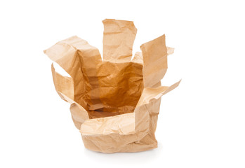 Ragged recycle paper bag on white background