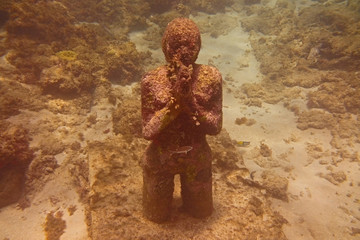 Underwater Sculpture of Girl Praying