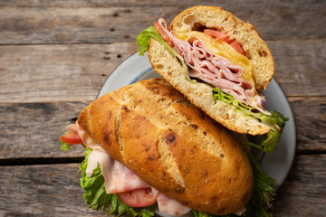 Poster Snack Ham and cheese sub sandwich with artisan bread