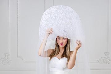 Amazed woman at russian traditional cap hat kokoshnik