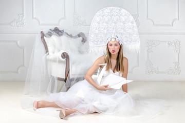 Portrait of beautiful blonde woman in fancy hat