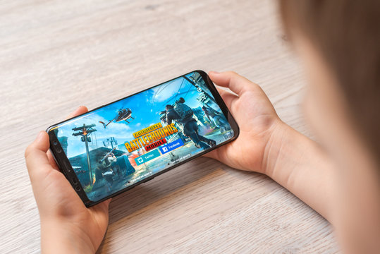 Sarajevo, Bosnia and Herzegovina - November 29, 2019: PlayerUnknown's Battlegrounds or PUBG online multiplayer battle royale game on Samsung Galaxy S9 plus smart phone in boy hands close-up