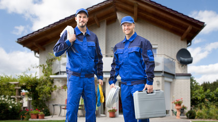 Two Male Electrician In Front Of House