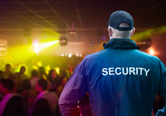Male Security Officer Standing In Night Club