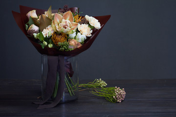 Bouquet in pastel colors in vintage style on a dark background, selective focus