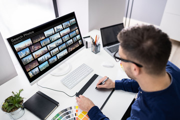 Editor Searching Photos On Computer