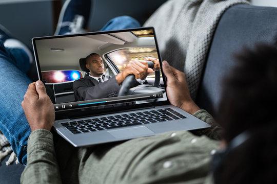 Man Watching Thriller Movie On Laptop