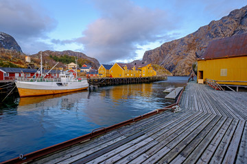Nusfjord, authentic fishing village with traditional yellow and red fishing houses Rorbu, Lofoten Islands, Norway, Scandinavia