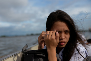 The Wider Image: Rising seas threaten early end for sinking village in Philippines