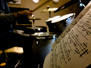 musician drummer practice with notes in the studio