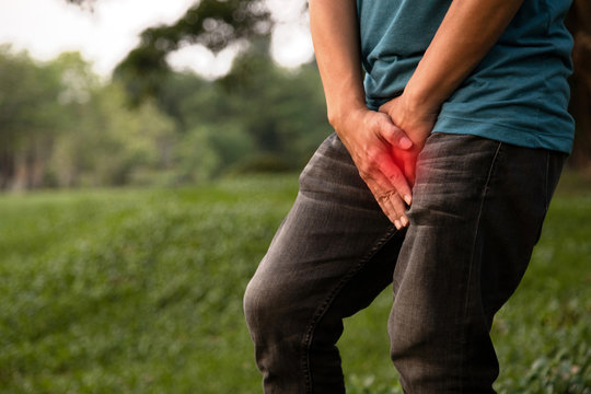 Asian man patient hands holding his crotch with prostate problems,feel itchy,sore and swollen,sick male people clings to a penis,bladder in pain or urinary incontinence,urinary frequency,health care