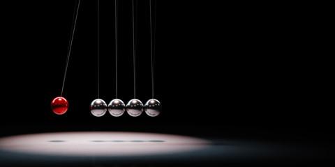 Metallic Balls Mechanism Spotlighted on Black Background