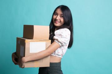 Delivery, relocation and unpacking.  young asian woman holding cardboard box.