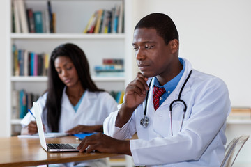 African american doctor at work with nurse