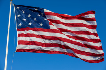 USA Flag Waving in Blue Background.