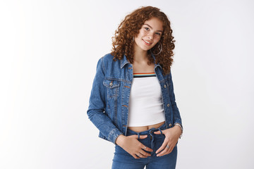 Portrait queer cute european redhead curly-haired freckled girl slightly plump hold hands pockets smiling happily accepting herself fighting stigma beautiful positive grin, standing white background