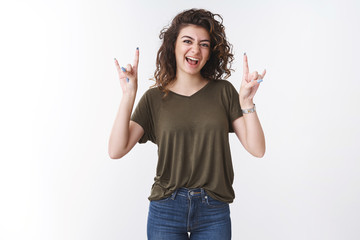Yeah I am awesome. Portrait carefree rebellious daring young woman yelling show tongue, rock-n-roll gesture like heavy metal music enjoy awesome beats, chill cool party standing white background