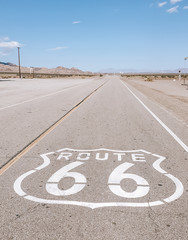 Route 66 sign on empty desert, Amboy in California, USA