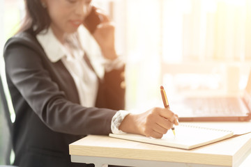 Close up of Business African American Woman Working sitting at her Desk