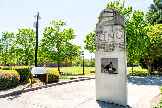 Atlanta, USA - April 20, 2018: Sign to Martin Luther King Jr National historic site in Georgia city in summer with park view