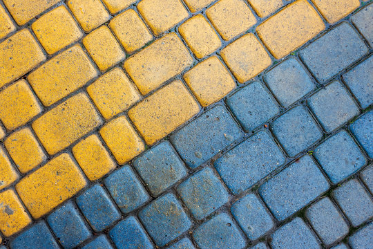 yellow and blue cobbles of pavement texture
