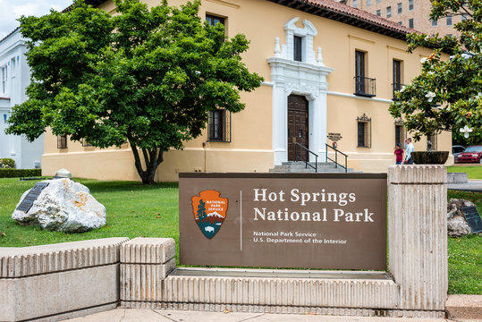 Hot Springs, USA - June 4, 2019: Historical Spa bath house row with sign on street in city for National Park Service Department of Interior