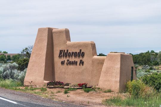 Santa Fe, USA - June 10, 2019: Eldorado sign near city for small residential community on adobe style building