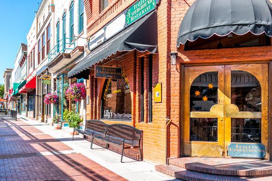 Glenwood Springs, USA - July 10, 2019: Historic street sidewalk in Colorado on Grand Avenue and Italian restaurant