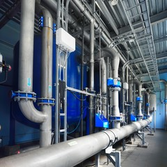 Large industrial water treatment and boiler room. Shiny pipes, pressure vessels, piping armateure
