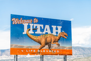 Dinosaur, USA - July 22, 2019: Colorado border city with welcome to Utah sign with life elevated text and animal picture