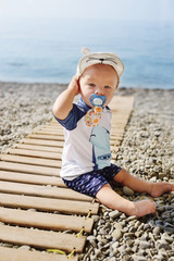 baby boy on the beach