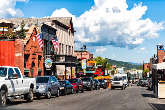 Park City, USA - July 25, 2019: Ski resort town in Utah during summer with downtown colorful historic buildings and cars