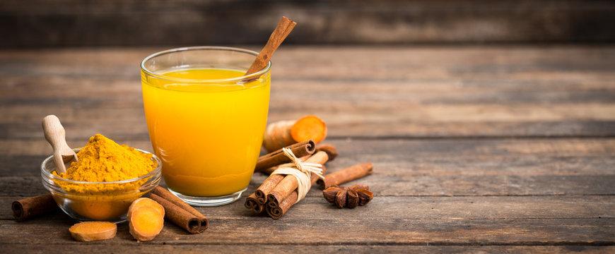 Healthy turmeric drink with honey, cinnamon, lemon and ginger