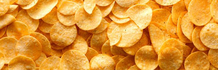 Potato chips panorama, texture, background.