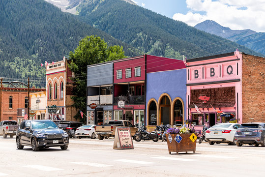 Silverton, USA - August 14, 2019: Small town village in Colorado with main road and colorful vibrant multicolored historic architecture houses and Blair street sign