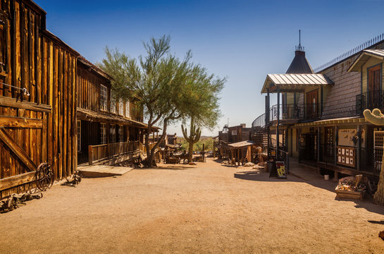 Old Western Goldfield Ghost Town square with huge cactus and saloon, photo taken during the sunny day with clear blue sky