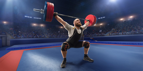 Male athlete squats with a barbell on a professional stadium. Stadium and crowd are made in 3d.