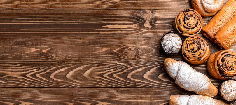 Tasty pastries on wooden background