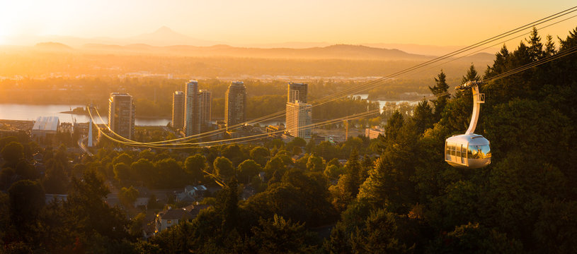 Cable car in Portland, Oregon, USA with wonderful view on sunrise with mt. Hood and aerial tram going to OHSU